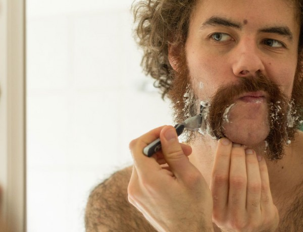 A guy shaving for movember.