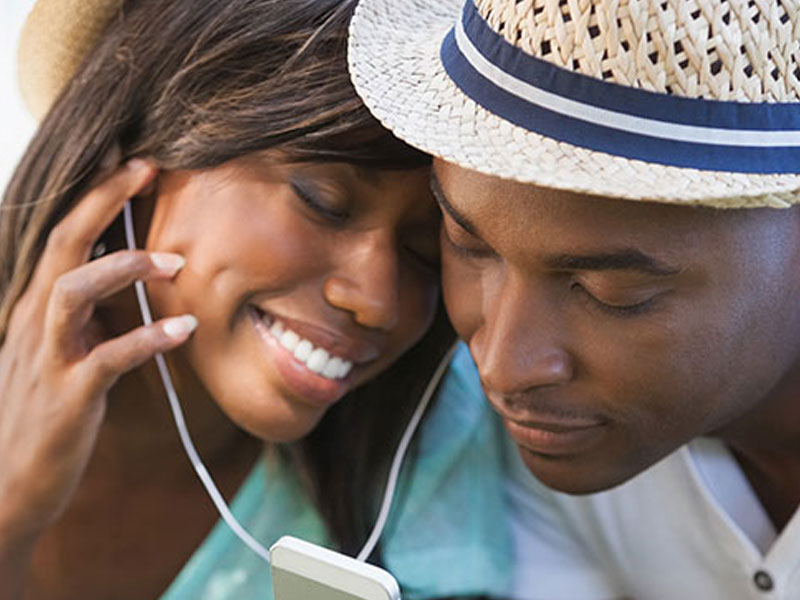 A couple listening to music together.