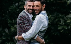 A happy couple of two men hugging.