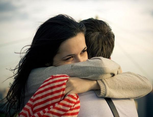 A woman hugging a man.