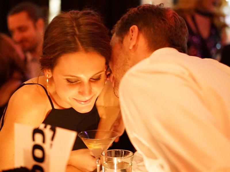 A man thinking of having an affair talking to a woman at a bar.