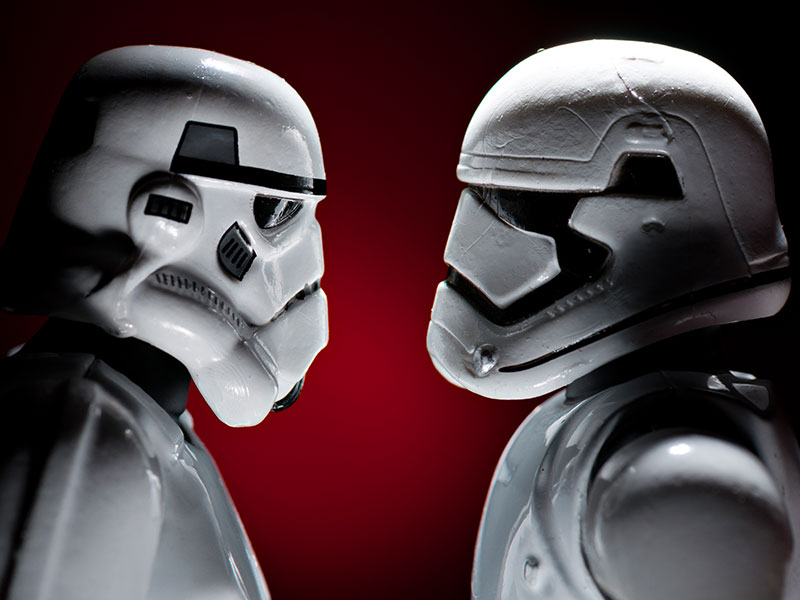 Two stormtroopers looking at each other as if in love.