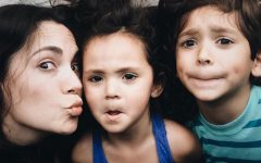 A single parent dating with kids making funny faces with her son and daughter.