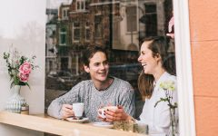 This couple is on a coffee date, one of the best date ideas according to women of all age groups.