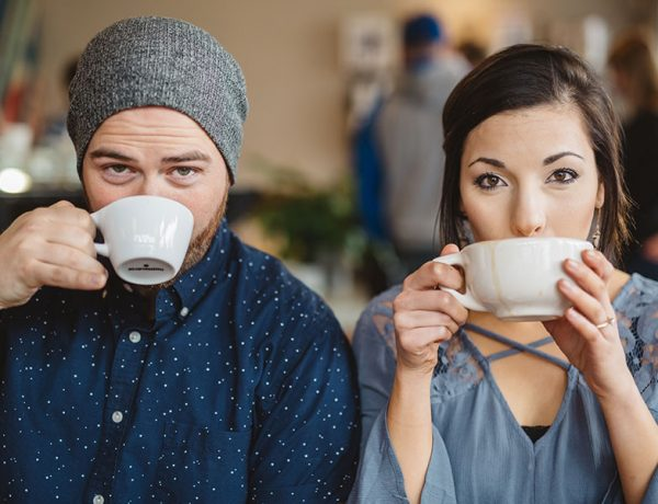 This woman learned how to meet men in real life and now she's sipping coffee with a nice guy at a coffee shop.