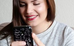 Want to learn about texting a guy you like? This woman texting her boyfriend did and is smiling about it.