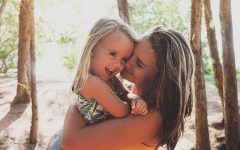 A mom who took these dating tips for single moms into account and is now happy and hugging her daughter in a forest.