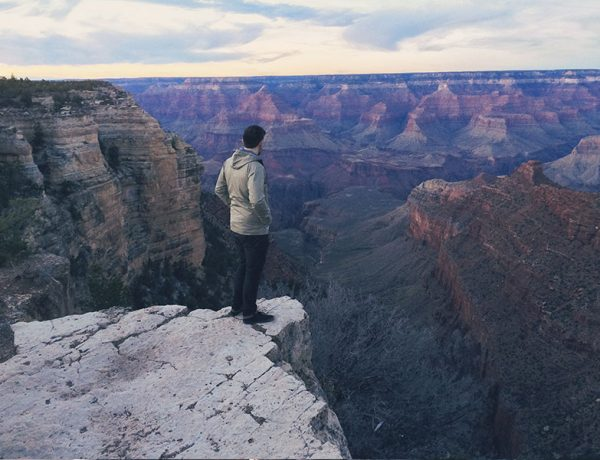 A man who listened to these lonely songs, songs about loneliness, and songs about being lonely on a cliff alone looking over a large empty canyon.