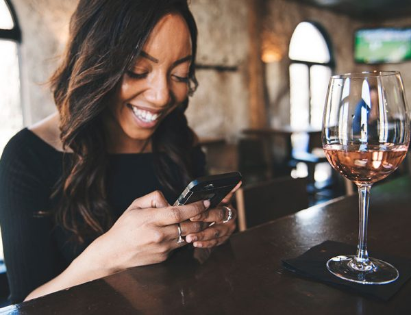 A woman answering a text from a man who wants to get a date with her.