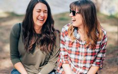 Two women discussing dating tips for women in their 20s and 30s while laughing together.