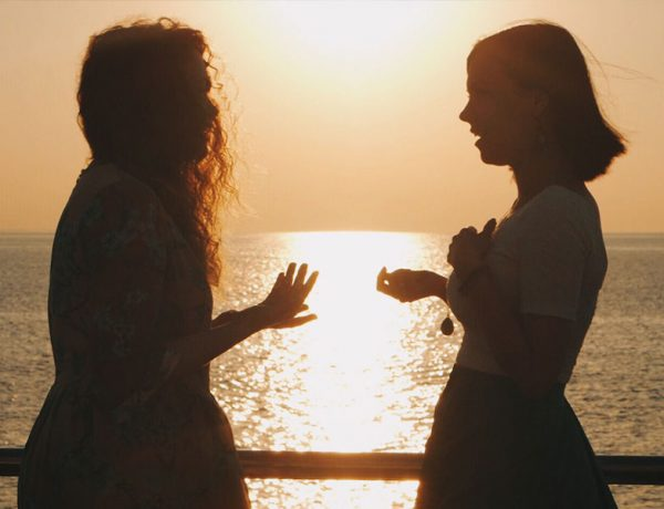 A woman telling her girlfriend I need space in a conversation on a pier.