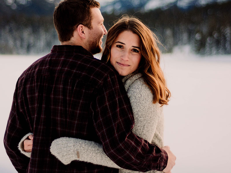 A woman who used online matchmaking and matchmaking services to snag the man she's hugging in the snow.