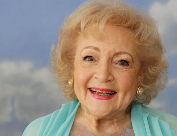 Betty white smiling at the camera about to give some dating tips.