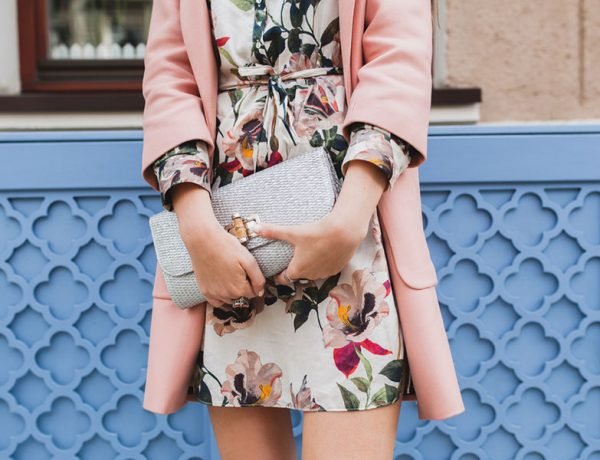 A woman wearing a flower dress from one of these date outfit ideas.