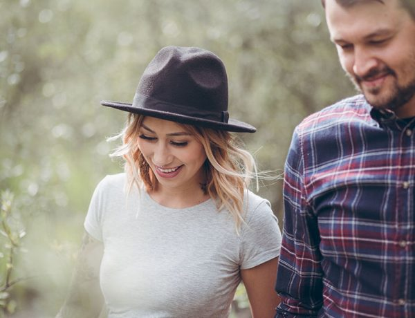 This couple walking in the woods together knows about younger women dating older men, because the man is five years older than his girlfriend.