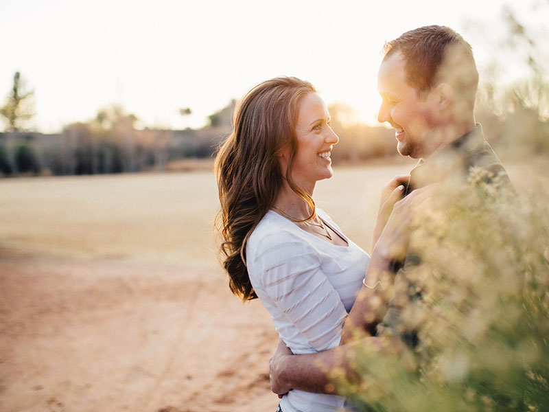 A happy couple hugging outside because they took these 5 tips for healthy relationships.
