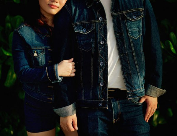 A couple wearing matching denim outfits who think about fashion and dating.