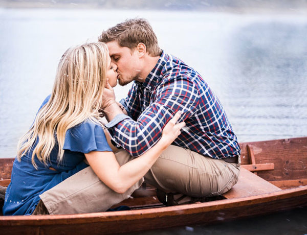A couple who experienced love at first sight, kissing on a boat during a date.