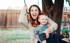 A mom who took this single parent dating advice on a swing with her kid laughing.