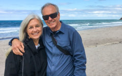A happy couple who listened to these senior dating tips smiling on the beach while having a great time.