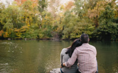 A couple dating after divorce at 40 leaning against each other as they look at a beautiful lake.