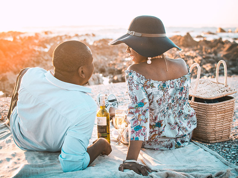 A couple who learned about these dating statistics from 2018 on a date at sunset.