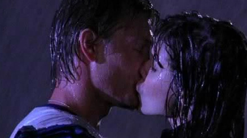 Lucas and Brooke kissing in the rain after his declaration of love.