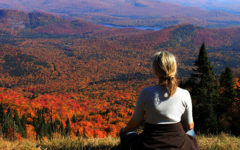 A woman after a breakup, sitting on a mountain meditating.