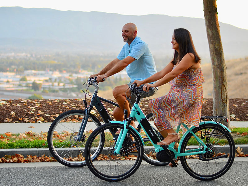 A man dating a single mom, riding bikes with her on their date together.