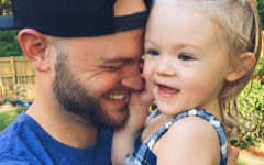 This single dad who's dating is hugging his daughter and laughing.