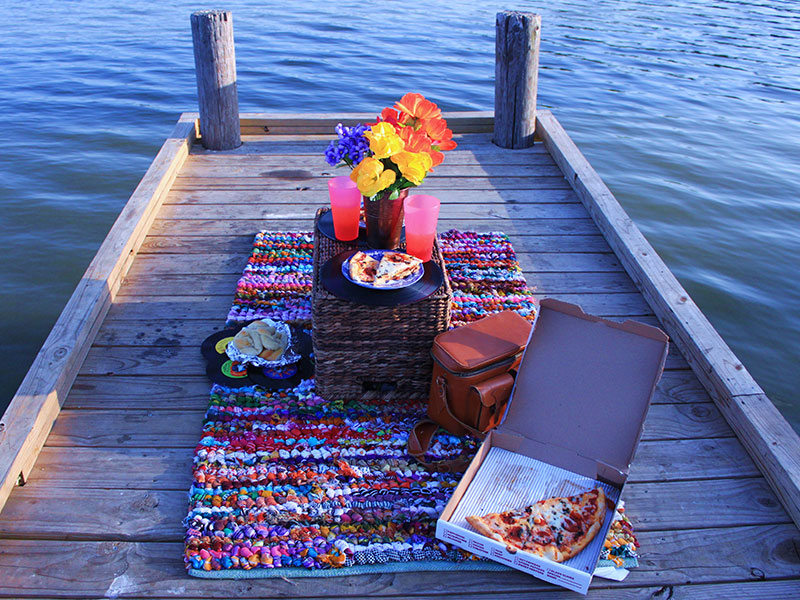 A creative third date idea, for a picnic on a dock.