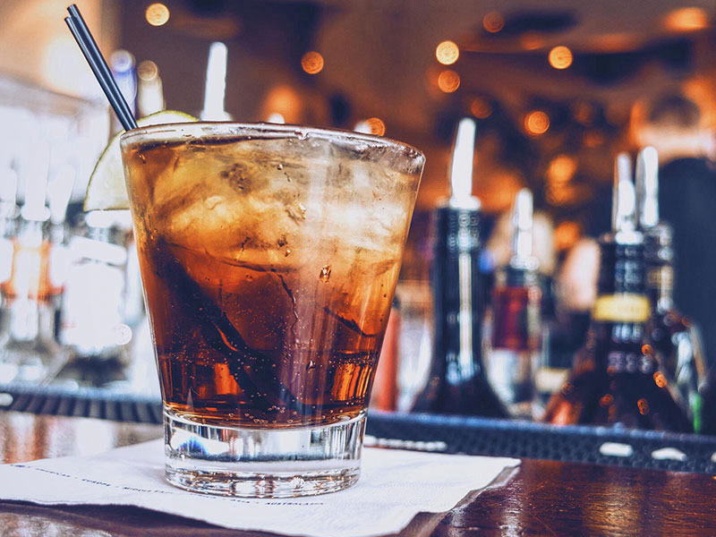 A drink on a bar.