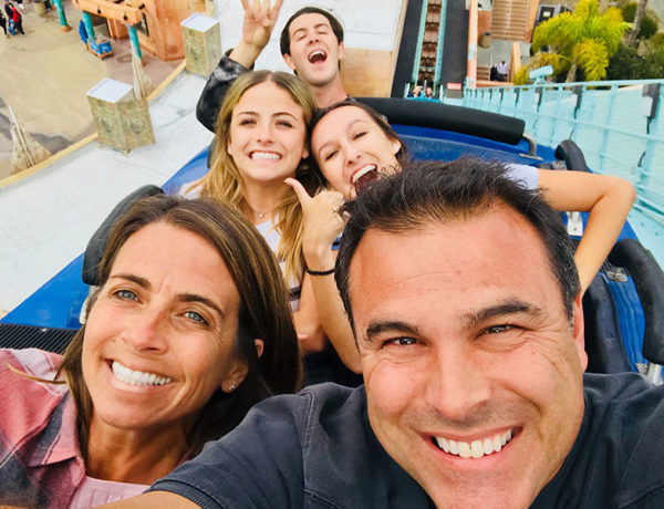 A man dating with kids after divorce, on a roller coaster with a date and his three teenaged kids.