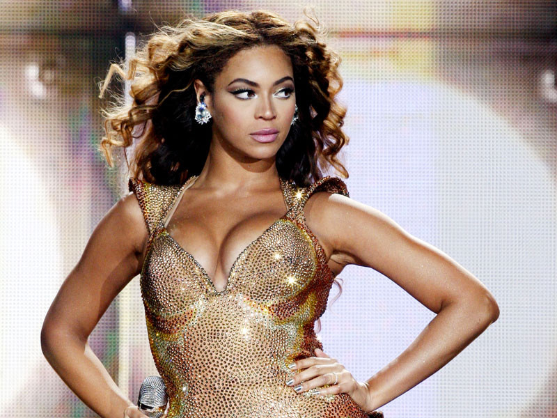 Beyonce on stage looking strong as she sings one of these songs about strong women.