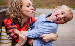 A mom who's learning how singles parents dating do it, trying to kiss her son as he laughs and pulls away.