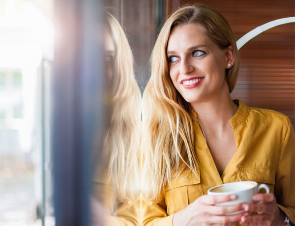 A woman at a coffee shop, a good place to meet single women.