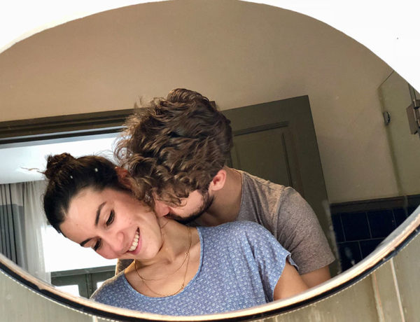 A couple who's always breaking up and getting back together kissing in front of a mirror.