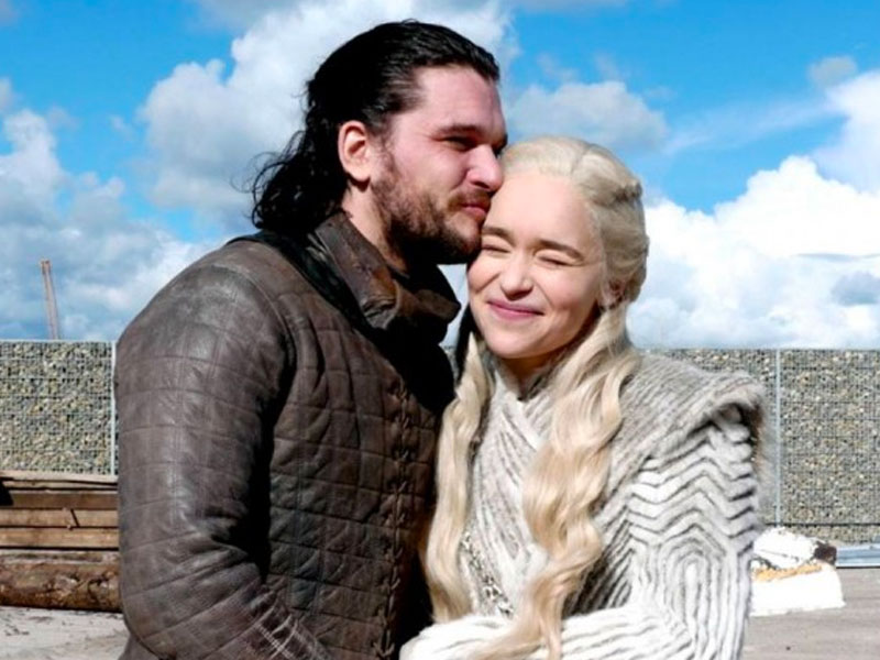 Jon Snow and Daenerys laughing and canoodling on the set of Game of Thrones.