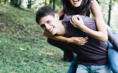A guy with a girl best friend, carrying her on his back as they laugh and tease each other.