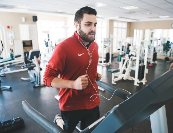 Man runs on treadmill to get in shape, because he's tired of being single.