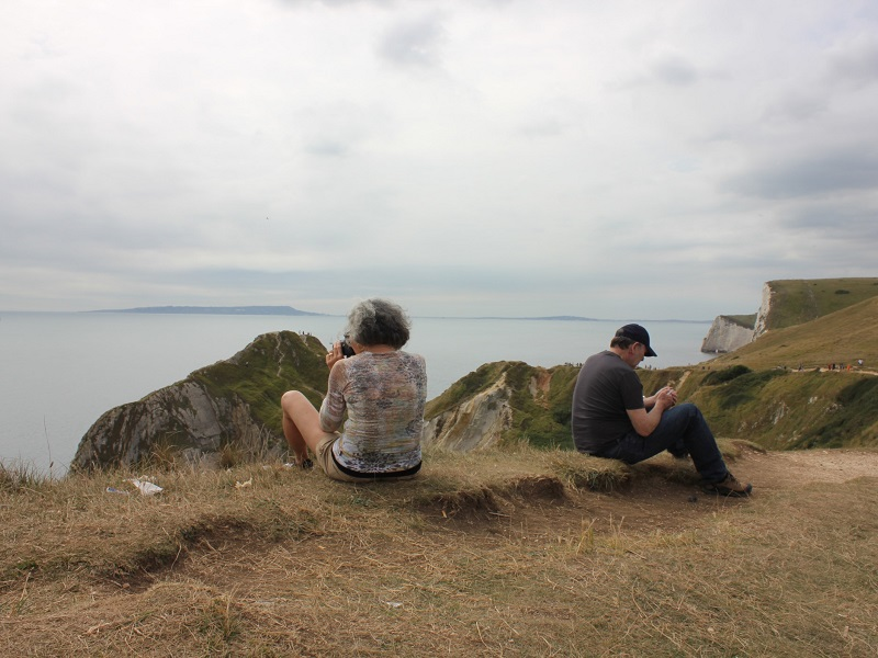 Frustrated couple overlooking the sea, considering should I get a divorce or not